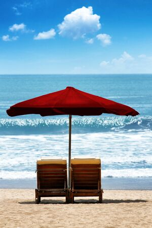 recliner: Two relax chairs on a beautiful and natural tropical beach with a clear blue sky on background. Stock Photo