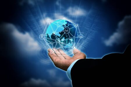 laptop computers: Conceptual image of businessman holding internet connectionglobe  between computers, server, laptop and smart phone