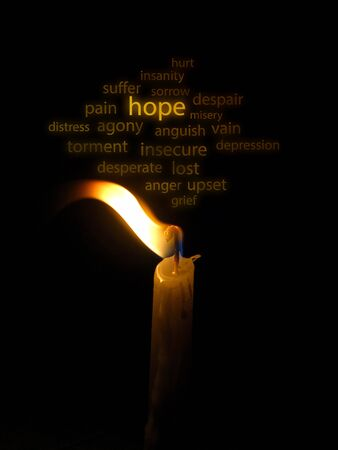 blown: Conceptual image of a hope illustrated with a candle light blown in the wind and wording on the background