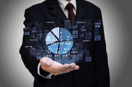 graficas de pastel: Business profit sharing concept with businessman showing a pie charts Foto de archivo