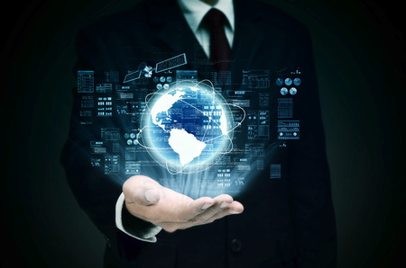 background information: Worldwide Internet Business control at the hand of businessman