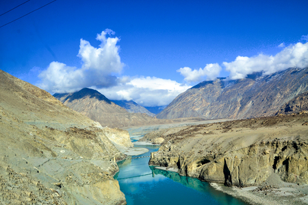 The Indus River is one of the longest rivers in Asia. Originating in the Tibetan Plateau in the vicinity of Lake Manasarovar, the river runs a course through the Ladakh region of Kashmir, towards Gilgit-Baltistan and the Hindukush ranges, and then flows in a southerly direction along the entire length of Pakistan to merge into the Arabian Sea near the port city of Karachi in Sindh Province