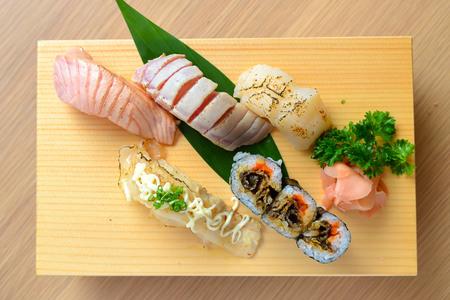 sushi set: Nigiri sushi set on wooden plate Stock Photo