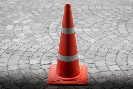 traffic cone: Traffic cone on  sidewalk Stock Photo