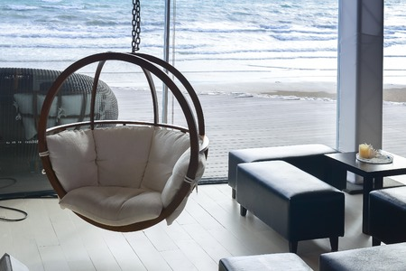 luxury furniture: house near beach decoration with hanging chair