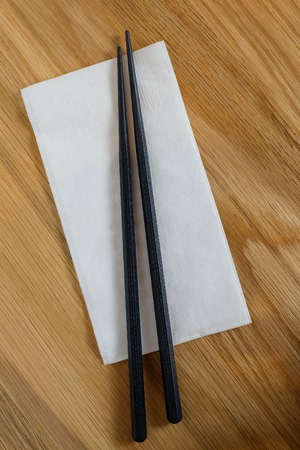 tissue paper: chopstick and tissue paper on wooden table Stock Photo