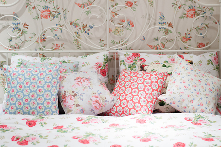 bedchamber: colorful pillows on a bed Comfortable soft pillows on the bed Stock Photo