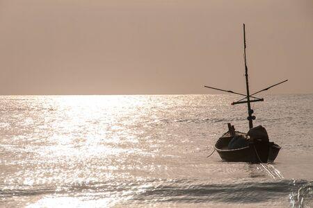 go forward: Fishing Boat floating on the sea in themorning goolden sun