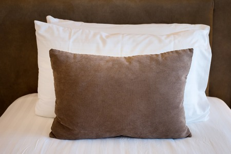 bedder: Comfortable soft pillows on the bed Stock Photo