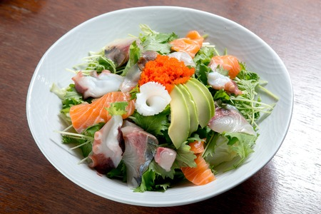 Fresh vegetable with various seafood served with japanese dressing - Japanese food
