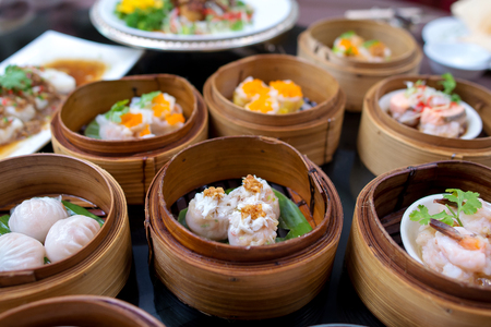 yumcha, various chinese steamed dumpling in bamboo steamer in chinese restaurant