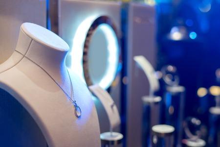 Fine luxury diamond jewellery window display with necklace carcanet chaplat choker pedant - whatta jewelry women want