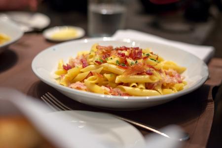 gastronome: Macaroni crispy bacon with creamy cheese sauce Stock Photo