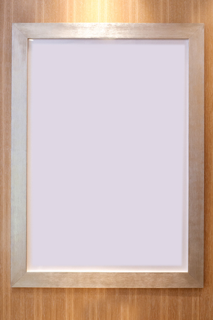 blank paper frames on wooden wall