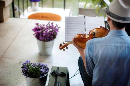 Blue shirt guy playing violin
