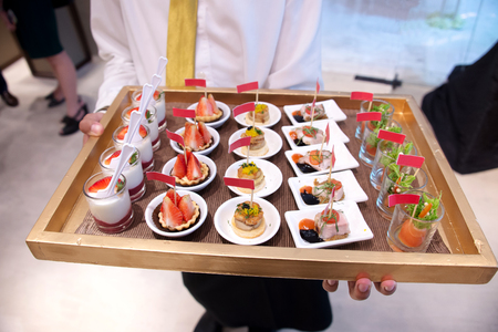 Canape service selection on slate platter