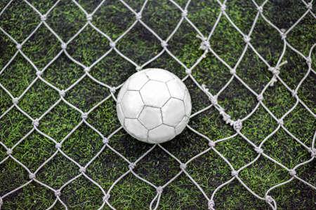 Still football behind the goalkeeper net in centre position