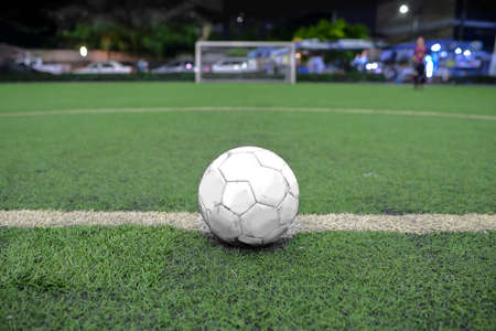 White Soccer field grass with ball at kick off point.