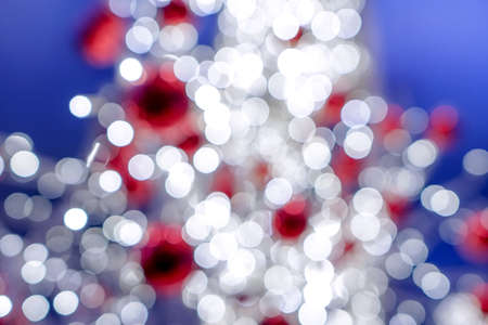 Red , white and blue holiday bokeh. Abstract Christmas background