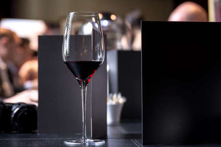 Glass of red wine on restaurant table