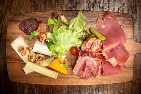 Italian salumi meat platter board  - prosciutto ham, salami and parmesan