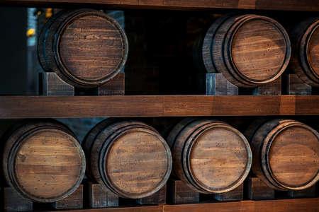 Wine Barrele in wine cellar Standard-Bild