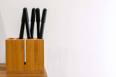 5 black pen in wooden pet pot