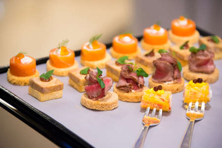 selective of canape on slate platter Stock Photo