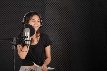 teenage female singer in music studio record room