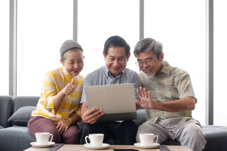 Group of asian grandparent talk with their family by online communication platform