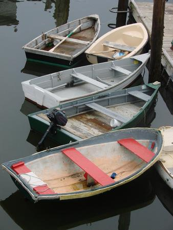 A group of dinghies at the fishing pier photo