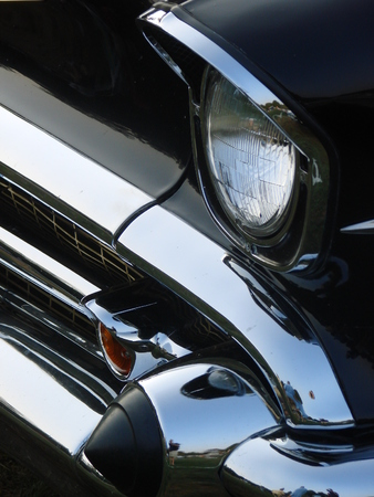 A grill and bumper of a classic automobile