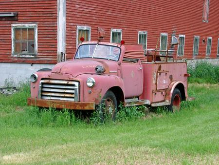 antique fire truck: Old red firetruck and old red barn