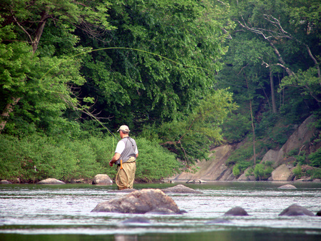 Fly fishing on the river Archivio Fotografico