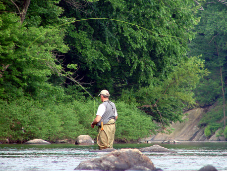 resting rod fishing: A fly fisherman on the river Stock Photo