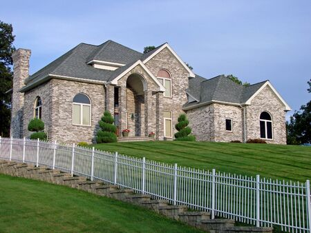 gated: A dream home on a well-manicured lot  Stock Photo