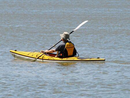 A man kayaks down a river Archivio Fotografico