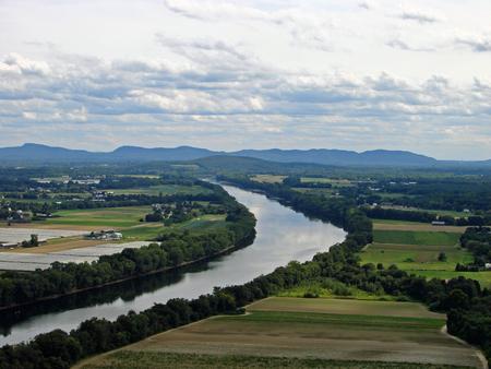 A pastoral, rural landscape of a river Archivio Fotografico