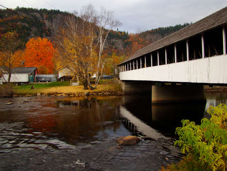 A covered bridge in New England during the fall photo