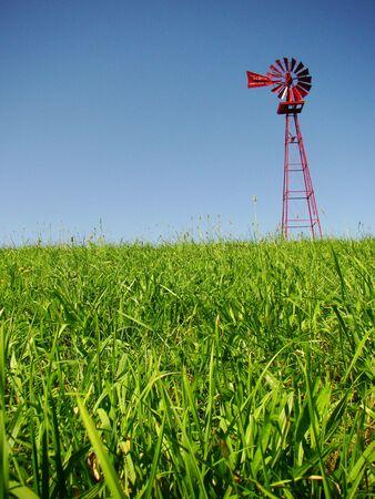 A windmill on a farm Archivio Fotografico