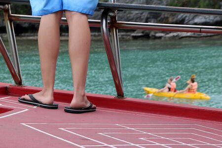 Feet of the people on the tour boat and kayak activities background at ang thong island Thailand. Stock Photo