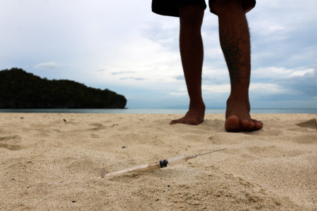 foot step: Foot step on injection needles on the beach.