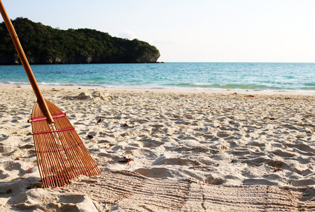 Bamboo broom and the beach. Stock Photo