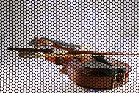 The Violin Background , concepts, shooting through the iron grating to see the shape of the violin, and blur the lens in some parts.