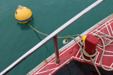 buoys: Rope tied the tour boat into the mooring buoys in Thailand