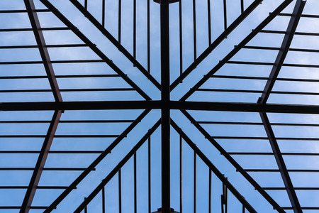 Metal roof structure with blue sky.