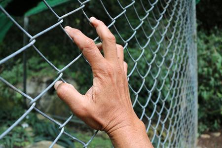 Hand holding steel grating