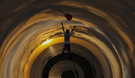 Men throwing the guitar with a red sky sunrise background, Circle design image. Stock Photo