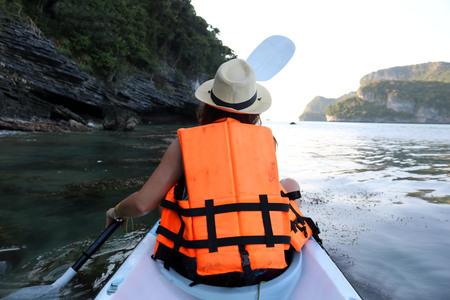caving: Womens kayaking along the Ang Thong archipelago islands,Thailand.