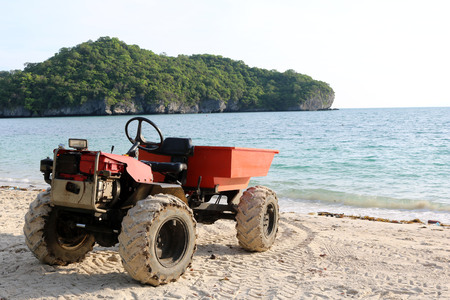 modified: Engine modified adapted to a small truck on the beach in Thailand.